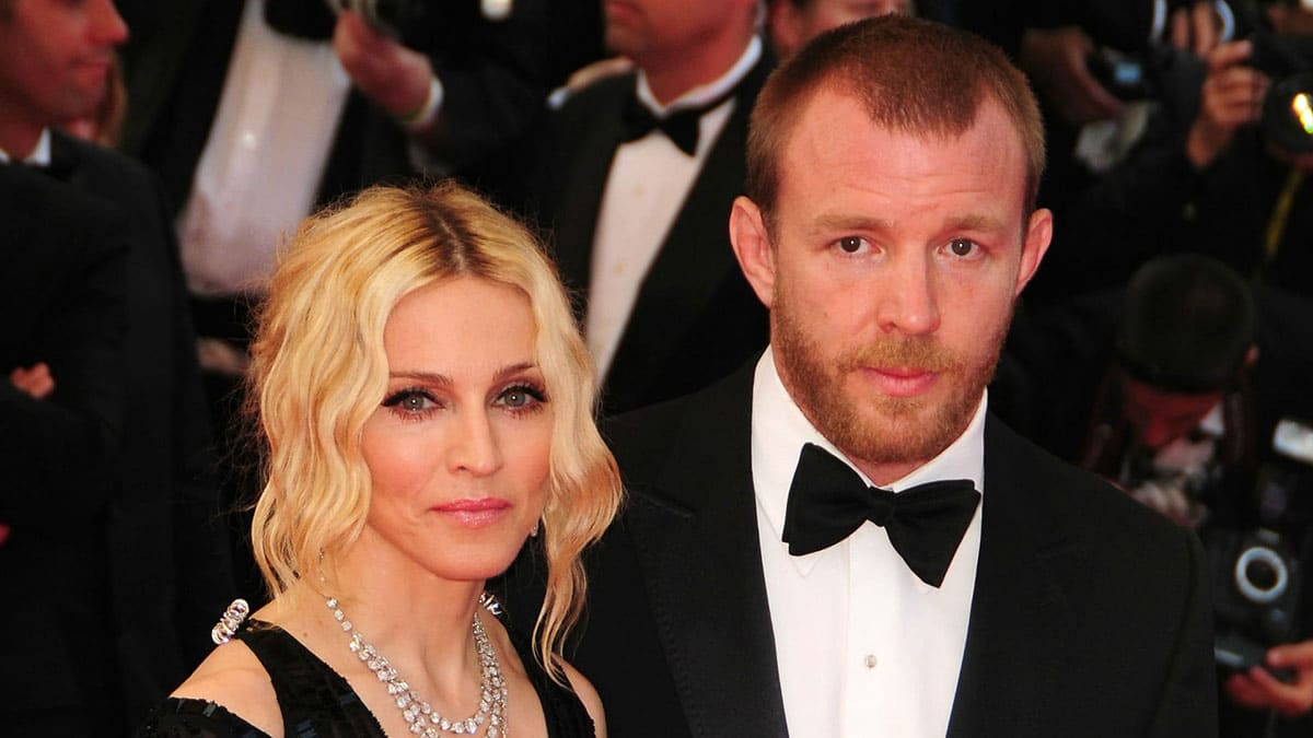 Madonna standing with Guy Ritchie