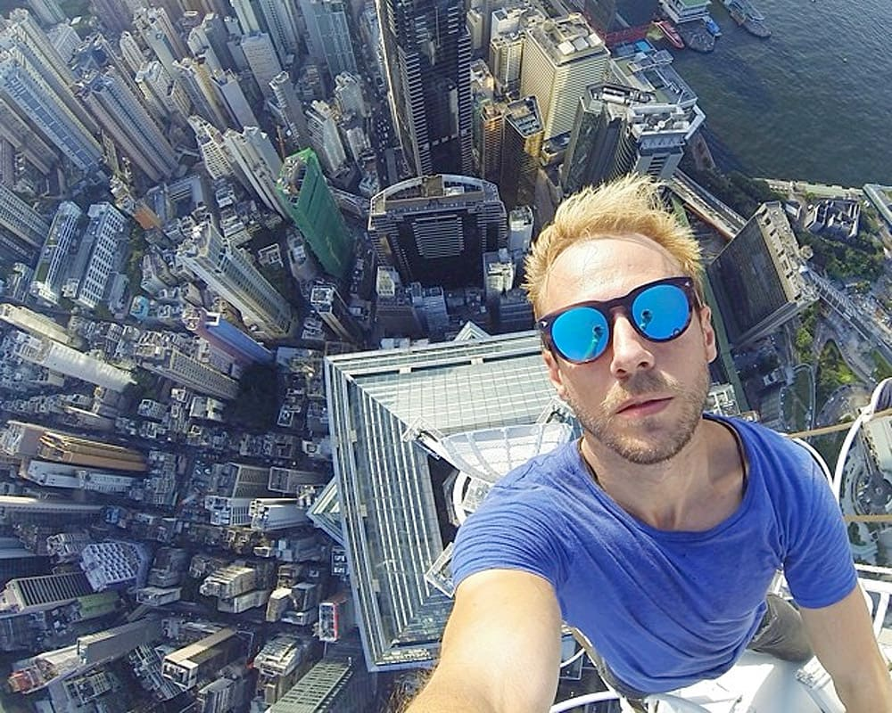 Man taking a selfie on the top of a skyscraper